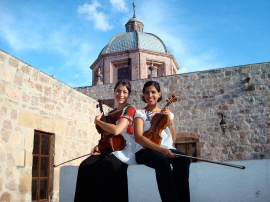 what's up with me and this pose with violinists? With Geeta Abad in Morelia, Mexico, 2008